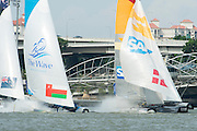 The Wave and SAP get a puff on the run. Day two of the Extreme Sailing Series regatta being sailed in Singapore. 21/2/2014