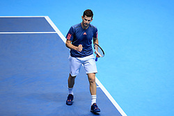 Austria's Dominic Thiem celebrates taking a point against Canada's Milos Raonic during day five of the Barclays ATP World Tour Finals at The O2, London.
