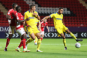 AFC Wimbledon defender Terell Thomas (6) with a shot on goal during the EFL Trophy match between Charlton Athletic and AFC Wimbledon at The Valley, London, England on 4 September 2018.