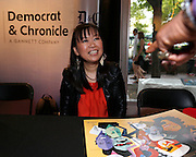 Akiko Tsuruga signs autographs in the Democrat and Chronicle's Digital Jazz Club on Friday, June 20, 2014.