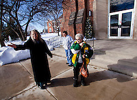 "CHAMPION, WI - DECEMBER 22: Care taker Karen Tipps, left, greets Debbie Banda, center, of Menasha Wis. along with Mary Young, right, of Bear Creek Wis. as they enter at the Shrine of Our Lady of Good Help in a small rural town in northern Wisconsin, December 22, 2010 in Champion, Wisconsin. After years of research, the Bishop of Green Bay determined that the sightings of Mary ""clothed in dazzling white"" are indeed ""worthy of belief"" and now have now been officially sanctioned as real by the Vatican. This shrine is the first of such for the United States and now joins the company of Lourdes and Fatima.   (Darren Hauck )"