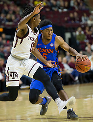 Florida guard KeVaughn Allen (5) drives against Texas A&M guard Jay Jay Chandler (0) during the second half of an NCAA college basketball game Tuesday, Jan. 2, 2018, in College Station, Texas. (AP Photo/Sam Craft)
