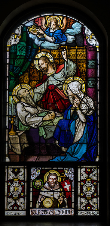 Stained glass image depicts death of St. Joseph. (Sam Lucero photo)