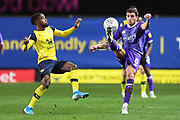 Shrewsbury Town midfielder Oliver Norburn (8) clears acrobatically under pressure from Oxford United midfielder Tarique Fosu-Henry  (11) during the EFL Sky Bet League 1 match between Oxford United and Shrewsbury Town at the Kassam Stadium, Oxford, England on 7 December 2019.