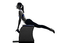 one caucasian woman exercising pilates chair exercises fitness in silhouette isolated on white backgound
