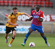 Dagenham central defender Nyron Nosworthy holds off a challenge from Newport County player Aaron Collins during the Sky Bet League 2 match between Dagenham and Redbridge and Newport County at the London Borough of Barking and Dagenham Stadium, London, England on 19 September 2015. Photo by Bennett Dean.