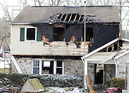 A burnt out home remains after a 2am fire Saturday February 6, 2016 in the 6000 block of Lower York Road in Solebury, Pennsylvania. (Photo by William Thomas Cain)