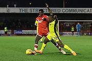 Alex Addai and Panutche Camara  during the EFL Sky Bet League 2 match between Crawley Town and Cheltenham Town at the Broadfield Stadium, Crawley, England on 5 January 2019.