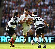 Twickenham - Sunday 30 May, 2010: Ben Foden of England is tackled by Fabrice Estabanez (21) and Cencus Johnston of the Barbarians during the match between England and the Barbarians at Twickenham. (Pic by Andrew Tobin/Focus Images)