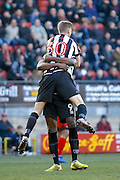 Notts County forward Jonathan Stead (30) and Notts County forward Shola Ameobi (9) celebrates his goal (score 0-2) during the EFL Sky Bet League 2 match between Leyton Orient and Notts County at the Matchroom Stadium, London, England on 18 February 2017. Photo by Andy Walter.