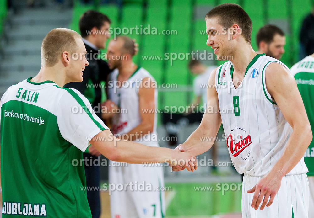 Sasu Salin #10 of KK Union Olimpija and Jaka Brodnik #8 of KK Union Olimpija after the basketball match between KK Union Olimpija Ljubljana and Asvel Villeurbanne Basket (FRA) in Round 7 of EuroCup 2013/14, on November 27, 2013 in Arena Stozice, Ljubljana, Slovenia. Photo by Vid Ponikvar / Sportida