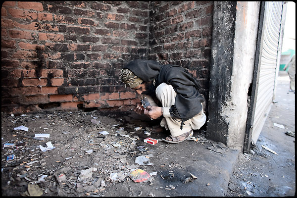 "A pathan man smokes heroin hid from the local people inside a broken building. Percentages of heroin and drug users are index of how many  people come from the NWFP. Morgh Mandi, Rawalpindi, Pakistan, on friday, November 28 2008.....""Pakistan is one of the countries hardest hits by the narcotics abuse into the world, during the last years it is facing a dramatic crisis as it regards the heroin consumption. The Unodc (United Nations Office on Drugs and Crime) has reported a conspicuous decline in heroin production in Southeast Asia, while damage to a big expansion in Southwest Asia. Pakistan falls under the Golden Crescent, which is one of the two major illicit opium producing centres in Asia, situated in the mountain area at the borderline between Iran, Afghanistan and Pakistan itself. .During the last 20 years drug trafficking is flourishing in the Country. It is the key transit point for Afghan drugs, including heroin, opium, morphine, and hashish, bound for Western countries, the Arab states of the Persian Gulf and Africa..Hashish and heroin seem to be the preferred drugs prevalence among males in the age bracket of 15-45 years, women comprise only 3%. More then 5% of whole country's population (constituted by around 170 milion individuals),  are regular heroin users, this abuse is conspicuous as more of an urban phenomenon. The substance is usually smoked or the smoke is inhaled, while small number of injection cases have begun to emerge in some few areas..Statistics say, drug addicts have six years of education. Heroin has been identified as the drug predominantly responsible for creating unrest in the society."""