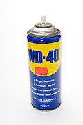 Cutout of a spry can of WD-40 oil on white background