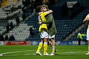 Leeds United midfielder Kalvin Phillips (23) and Leeds United forward Patrick Bamford (9) embrace air full time during the EFL Sky Bet Championship match between Preston North End and Leeds United at Deepdale, Preston, England on 9 April 2019.