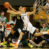 Oregon State's Gabriella Hanson (11) tries to steal the ball from Oregon's Lexi Petersen in the second half of an NCAA college basketball game, in Corvallis, Ore., on Friday, Jan. 8, 2016. Oregon State won 60-33. (AP Photo/Timothy J. Gonzalez)