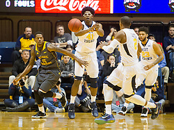 Nov 23, 2015; Morgantown, WV, USA; West Virginia Mountaineers forward Devin Williams passes the ball to guard Jevon Carter during the first half against the Bethune-Cookman Wildcats at WVU Coliseum. Mandatory Credit: Ben Queen-USA TODAY Sports