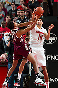 Louisville forward Anas Mahmoud, right, blocks a shot by Eastern Kentucky forward Zach Charles in the second half. The University of Louisville hosted Eastern Kentucky University, Saturday, Dec. 17, 2016 at The KFC Yum Center in Louisville. Louisville won 87-56.