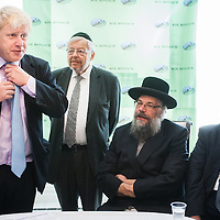 London, UK - 7 August 2014: The Mayor Boris Johnson visits Rabbi Oscher Schapiro (third from left) and the Orthodox Jewish community in Stamford Hill, London