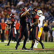 15 September 2018: San Diego State Aztecs linebacker Kyahva Tezino (44) and defensive lineman Anthony Luke (45) celebrate after a tackle in the first quarter. The Aztecs beat the Sun Devils 28-21 at SDCCU Stadium in San Diego, California.