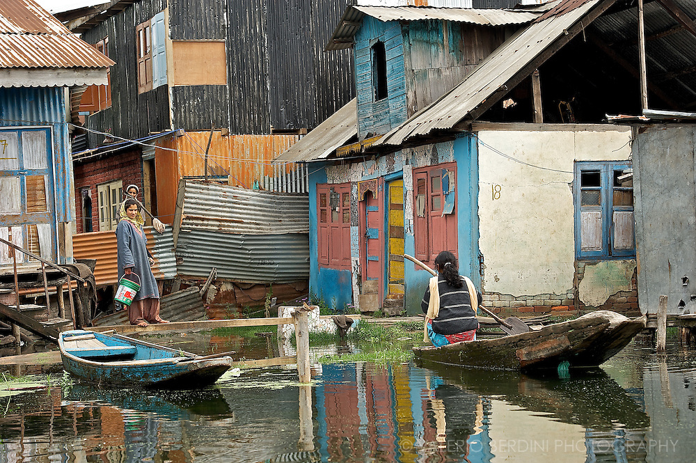 Women keep houses and children while men go fishing or working to the gardens in a typical day on the Dal Lake. Srinagar. Kashmir. India