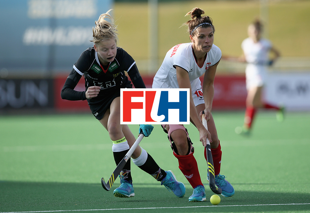 JOHANNESBURG, SOUTH AFRICA - JULY 8: Naomi Heyn of Germany and Natalia Wisniewska of Poland battle for possesion during the pool A match between Germany and Poland on day one of the FIH Hockey World League Semi-Final at Wits University on July 8, 2017 in Johannesburg, South Africa. (Photo by Jan Kruger/Getty Images for FIH)
