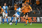 Blackburn Rovers player Bradley Dack (23) and Hull City player Reece Burke (5) during the EFL Sky Bet Championship match between Hull City and Blackburn Rovers at the KCOM Stadium, Kingston upon Hull, England on 20 August 2019.