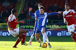 Peterborough United's Tommy Rowe in action with Swindon Town's Nathan Thompson - Photo mandatory by-line: Joe Dent/JMP - Tel: Mobile: 07966 386802 11/01/2014 - SPORT - FOOTBALL - County Ground - Swindon - Swindon Town v Peterborough United - Sky Bet League One