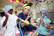 Child Life Specialist Hanlie Snyman-Gerritse with 028, Sinovuyo Dikani and 004 Ethjan Botha before surgery. <br /> Operation Smile South Africa&rsquo;s 2015 mission to Mbombela. Rob Ferreira hospital during South Africa.<br /> <br /> (Operation Smile Photo - Zute Lightfoot)