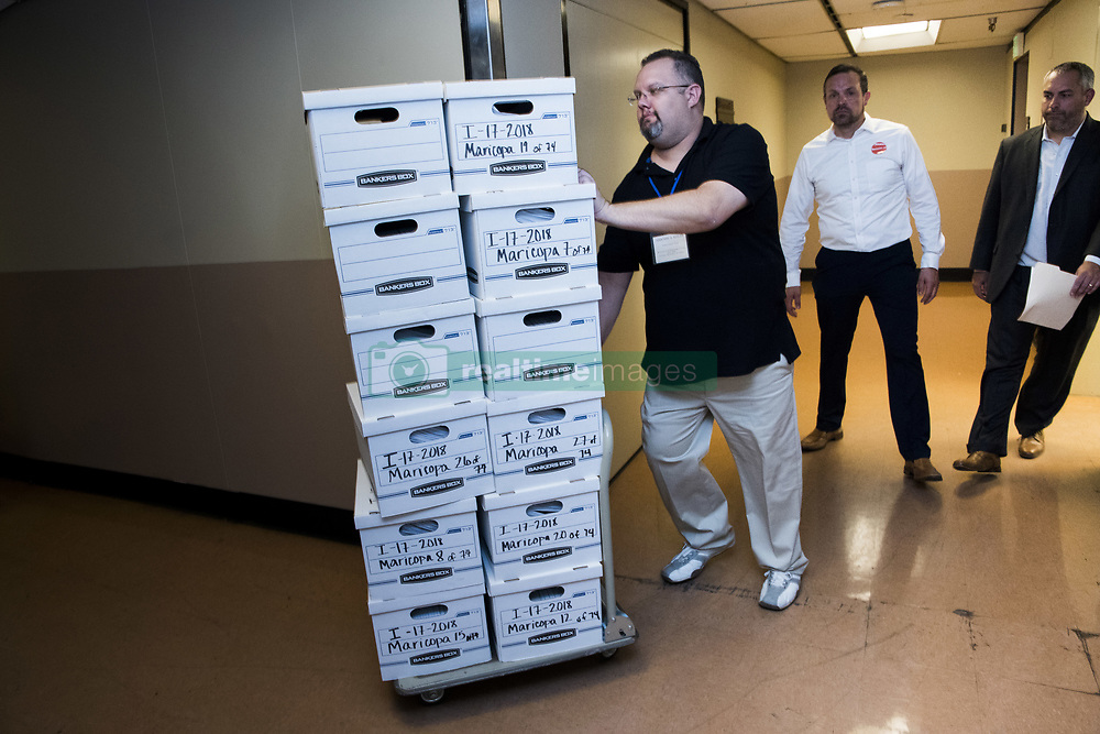 July 5, 2018 - Phoenix, Arizona, U.S - Petitions to get an income tax added to the Arizona november ballot to improve school funding make their way to recording and processing in the state secretary of state's office in Arizona. (Credit Image: ©  via ZUMA Wire)
