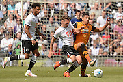 Derby County midfielder Craig Bryson tackles Hull City midfielder Jake Livermore during the Sky Bet Championship play-off first leg match between Derby County and Hull City at the iPro Stadium, Derby, England on 14 May 2016. Photo by Alan Franklin.