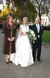 The bride CLEMENTINE HAMBRO wither her parents  RICHARD HAMBRO and the COUNTESS PEEL at the wedding of Clementine Hambro to Orlando Fraser at St.Margarets Westminster Abbey, London on 3rd November 2006.<br />