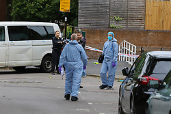 © Licensed to London News Pictures. 04/07/2020. London, UK. Forensic officers on Roman Way, Islington in north London as police launch a murder investigation following fatal shooting. Police were called at at 3.20pm to Roman Way, following reports of shots fired.  Officers attended with LAS and found a man, believed to be aged in his early 20s, suffering from gunshot injuries. Despite their best efforts, he was pronounced dead at the scene. Photo credit: Dinendra Haria/LNP