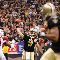 16 January 2010:  New Orleans Saints quarterback Drew Brees (9) throws a touchdown to wide receiver Marques Colston (foreground) during a 45-14 win by the New Orleans Saints over the Arizona Cardinals in a 2010 NFC Divisional Playoff game at the Louisiana Superdome in New Orleans, Louisiana.