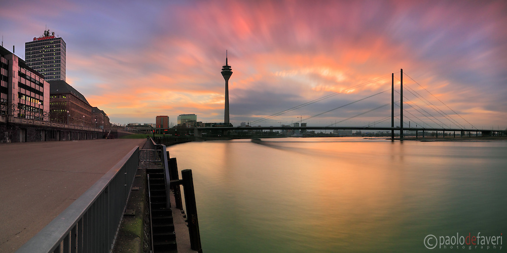 """Dusseldorf, Germany. A view of the Rhine river at sunset, with the TV tower and the motorway bridge in the background. Taken at sunseton a evening of February this is a stitch of 8 vertical frames, each one exposed for 50""""."""