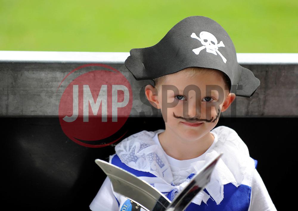 A young Bristol Rovers' fan dresses as a pirate - Photo mandatory by-line: Dougie Allward/JMP - Mobile: 07966 386802 27/07/2014 - SPORT - FOOTBALL - Bristol - Bristol Rovers - - Memorial Stadium - Fun Day