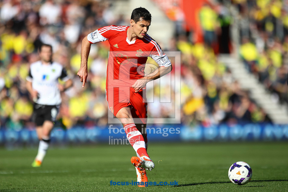 Dejan Lovren of Southampton plays a pass during the Barclays Premier League match at the St Mary's Stadium, Southampton<br /> Picture by Daniel Chesterton/Focus Images Ltd +44 7966 018899<br /> 15/03/2014