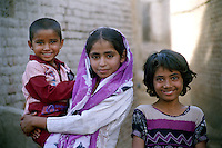 Pakistan, Sehwan Sharif, 2004. Children give a warm welcome to strangers and pilgrims alike along the back streets of Sehwan.