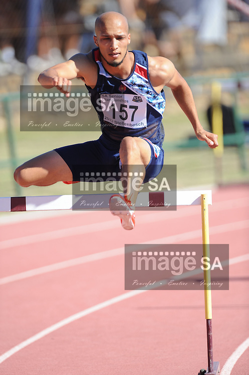 STELLENBOSCH, South Africa - Saturday 13 April 2013, Cornell Fredericks in the mens 400m hurdles final during day 2 of the South African Senior Athletics championships at the University of Stellenbosch's Coetzenburg stadium.Photo by Roger Sedres/ ImageSA