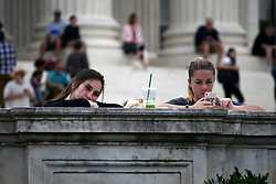 October 6, 2018 - Washington, DC, United States - Two young women rest and watch from the steps of the US Supreme Court as a rally against is going on the expected confirmation of Judge Brett Kevanaugh, in Washington D.C., on  October 6, 2018. (Credit Image: © Bastiaan Slabbers/NurPhoto/ZUMA Press)