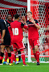 Bristol City U21's Bobby Reid congratulates goalscorer Tom King - Photo mandatory by-line: Dougie Allward/Josephmeredith.com  - Tel: Mobile:07966 386802 04/09/2012 - SPORT - FOOTBALL - Professional Development League -  Bristol  - Ashton Gate -  Bristol City U21s v Brentford U21s