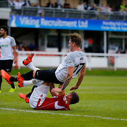 AUGUST 12:  Dover Athletic against Wrexham in Conference Premier at Crabble Stadium in Dover, England. Dover's forward Ryan Bird falls over Wrexham's midfielder Marcus Kelly. (Photo by Matt Bristow/mattbristow.net)