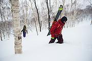 Josh Dirksen leads Gerry Lopez up through the birch tress in the Niseko bakcountry. Hokkaido, Japan.