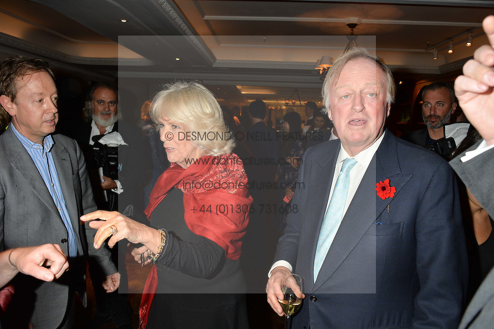 The DUCHESS OF CORNWALL and her former husband ANDREW PARKER BOWLES at a party hosted by Ewan Venters CEO of Fortnum & Mason to celebrate the launch of The Cook Book by Tom Parker Bowles held at Fortnum & Mason, 181 Piccadilly, London on 18th October 2016.