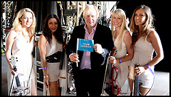 Boris Johnson with the group Bond backstage at the Celebration of the 2012 Olympic Games volunteering one year on at the  Queen Elizabeth Olympic Park.<br /> Mayor of London Boris Johnson and Lord Coe will be taking to the stage at Go Local to encourage a new drive in volunteering one year on from the Games. Also present are multi-platinum selling pop rock band McFly; world famous comedian Eddie Izzard, Brit Award nominated The Feeling, and Britain'Got Talent winners Attraction, in addition to stars Jack Carroll and Gabz. The event will be the UKs biggest ever celebration of volunteering and first Olympic and Paralympic legacy event at Queen Elizabeth Olympic Park.<br /> London, United Kingdom<br /> Friday, 19th July 2013<br /> Picture by Andrew Parsons / i-Images