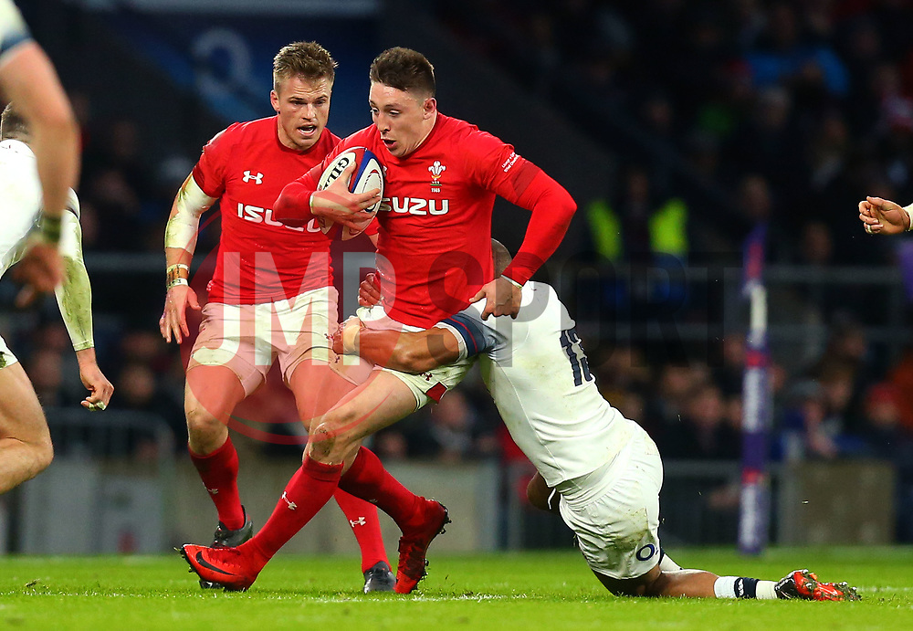 Josh Adams of Wales is tackled by Jonathan Joseph of England - Mandatory by-line: Robbie Stephenson/JMP - 10/02/2018 - RUGBY - Twickenham Stoop - London, England - England v Wales - Women's Six Nations