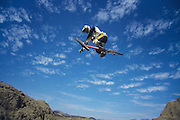 Man on mountain bike jumping low angle view