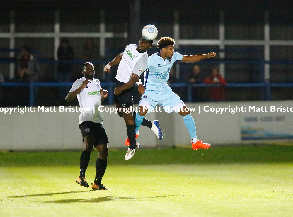 SEPTEMBER 12:  Top of the table Dover Athletic FChost eighth place Boreham Wood FC in Conference Premier at Crabble Stadium in Dover, England. The visitors, Boreham Wood  ran out winners a goal to nothing. Boreham Wood's Dean Wells and Dover's defender Femi Ilesanmi both contest the ball.    (Photo by Matt Bristow/mattbristow.net)