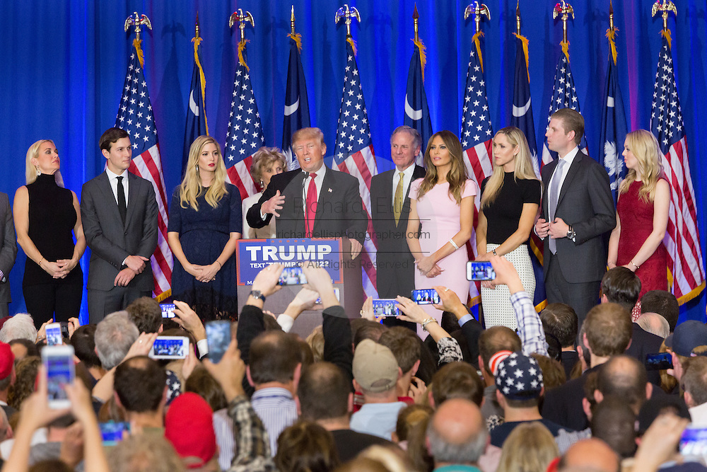 Billionaire and GOP presidential candidate Donald Trump addresses supporters along with family and Lt. Gov. Henry McMasters as they celebrate victory in the South Carolina Republican primary February 20, 2016 in Spartanburg, South Carolina, USA .
