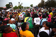 Crowds gather to mourn the death and celebrate the life of Nelson Rolihlahla Mandela outside his former home in Vilakazi street in Soweto. Johannesburg. South Africa<br />