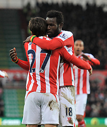 Stoke's Bojan Krkic celebrates his goal with Stoke's Mame Biram Diouf - Photo mandatory by-line: Dougie Allward/JMP - Mobile: 07966 386802 - 06/12/2014 - SPORT - Football - Stoke - Britannia Stadium - Stoke City v Arsenal - Barclays Premie League